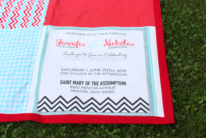 wedding invitation on beach blanket